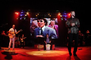 The Monkees (Michael Nesmith, Micky Dolenz and Peter Tork with the late Davy Jones on screen behind) (photo credit: JEFF DALY/THE ASSOCIATED PRESS)