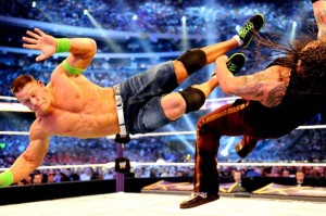 John Cena, one of the 50 greatest, dropkicks Bray Wyatt (photo courtesy: WORLD WRESTLING ENTERTAINMENT)