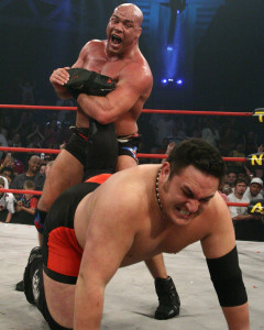 Kurt Angle, one of the 50 greatest, puts an ankle lock on Samoa Joe (photo courtesy: TOTAL NONSTOP ACTION)