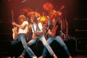 Status Quo (On the Front Line: Rick Parfitt, Francis Rossi, Alan Lancaster) (uncredited photo)