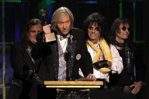 Neal Smith's Rock and Roll Hall of Fame induction speech, flanked by Michael Bruce, Alice Cooper and Dennis Dunaway, 2011 (uncredited photo)
