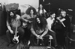 Kansas, circa 1974 (Dave Hope, Rich Williams, Robby Steinhardt, Phil Ehart, Steve Walsh, Kerry Livgren) (publicity photo)