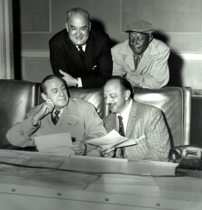 "Mel Blanc with, from lower left, Jack Benny, Don Wilson and Eddie ""Rochester"" Anderson (publicity photo)"