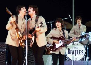 EIGHT DAYS A WEEK: THE TOURING YEARS (Paul McCartney, John Lennon, George Harrison, Ringo Starr at Shea Stadium, 1965) (uncredited photo)