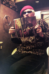 Captain Sensible in repose (with fLUSH issue 11), 2002 (photo credit: DARREN TRACY)